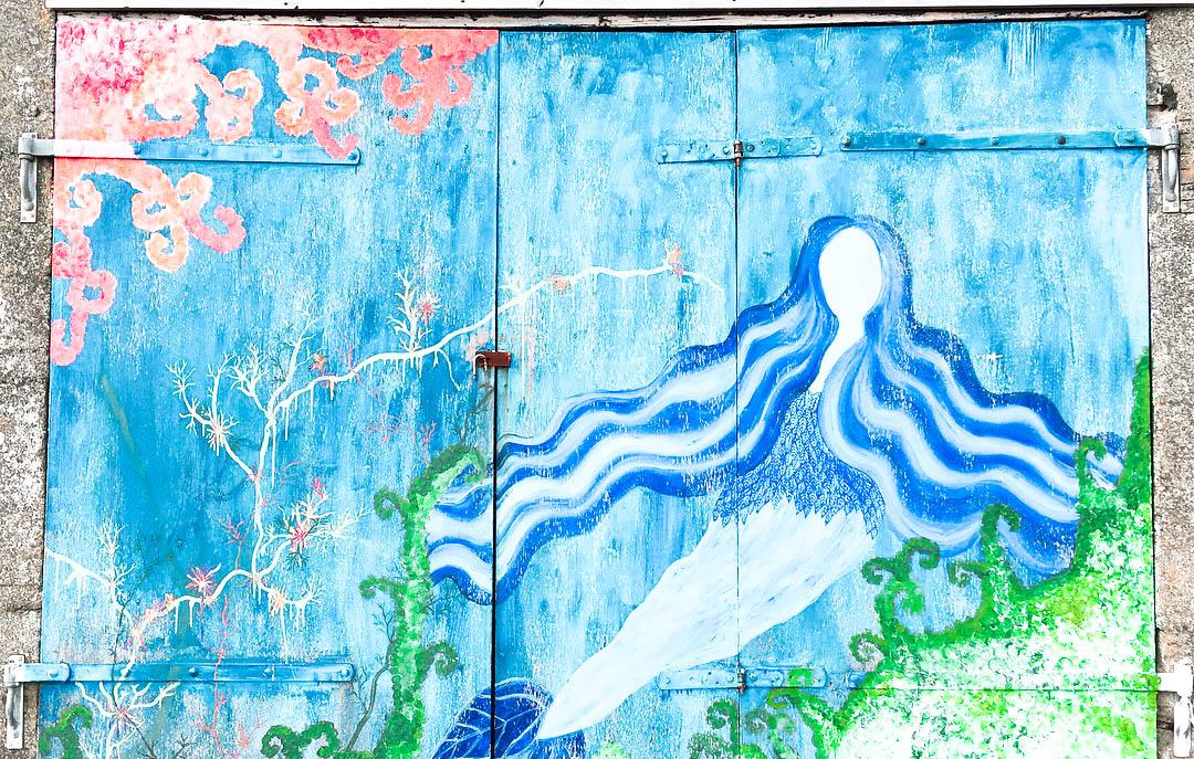 Street art Selkie Mural in Nolsoy Faroe Islands